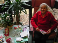 Gran getting presents on CHRISTmas Day 2002