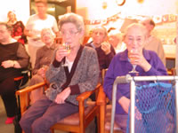 Jessie enjoys a festive drink with her best friend (Gran) during my All Singing All Dancing festive juggling show!